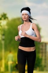 Woman running in green park