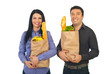 Smiling couple shopping groceries