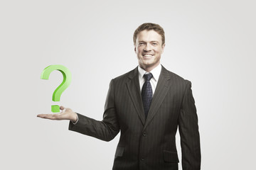 Young  businessman with a question mark on his hand