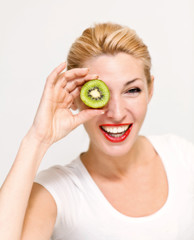 Beautiful woman`s face with kiwi