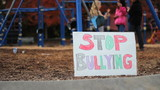 Students With Anti-Bullying Sign At School