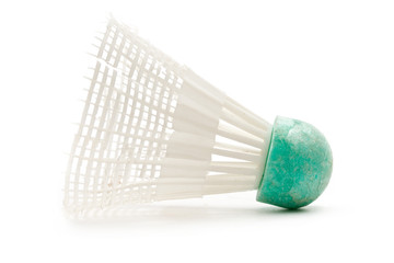White-and-green shuttlecock on the white background