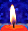 Closeup of a burning red candle