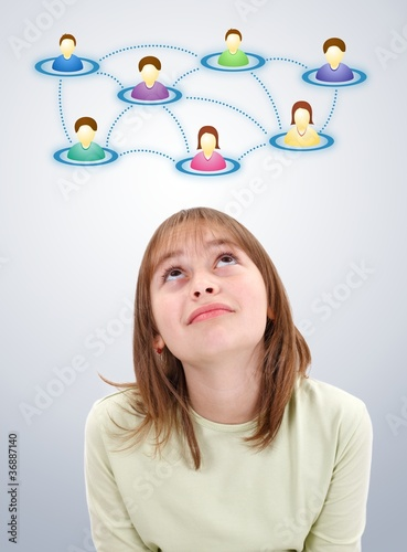Teen girl looking up to social network