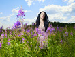 Beautiful lady in a flower meadow
