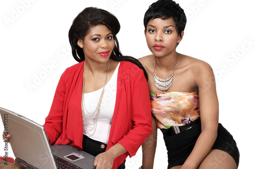 Pretty girls shopping online on laptop