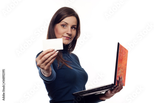 Smiling pretty girl with notebook and blank