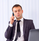 Business man working at office and calling on phone