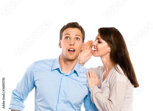 Leinwanddruck Bild Frau flüstert Mann ins Ohr
