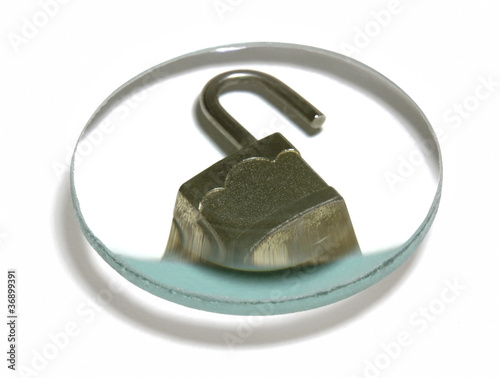 open padlock under glass lens