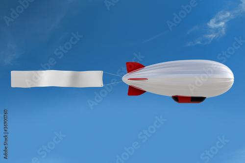 Leinwandbild Motiv Zeppelin mit Banner
