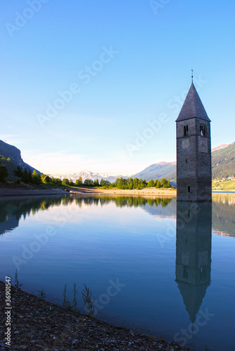 Resia lake with tower