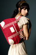 Beautiful fashion model with bag posing in the studio