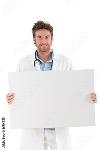 Young doctor with blank sheet smiling