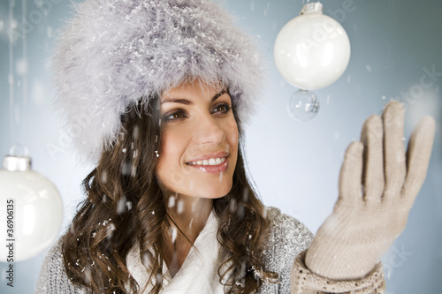A young woman looking at a glass bauble