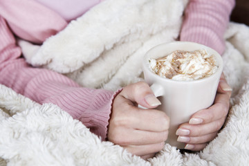 A woman holding a cup of hot chocolate