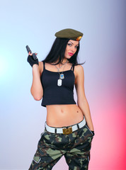 attractive girl with hand gun