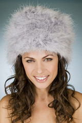 A young woman wearing a winter hat, smiling