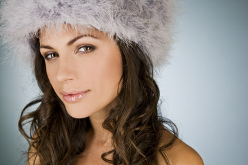 A young woman wearing a winter hat