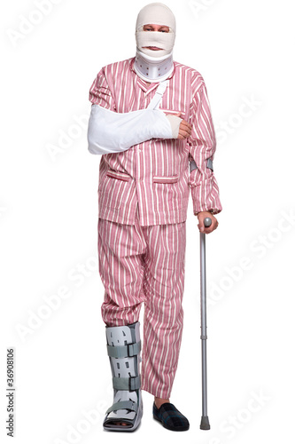 Injured man walking on crutches