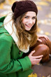 Young woman outdoors, wearing woolen hat