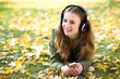 Girl listening music outdoors