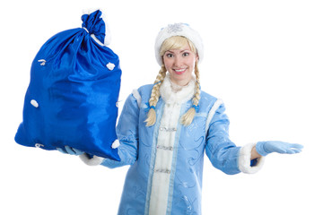 girl in christmas costume of Snegurochka with big present