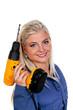 Frau in blauer Arbeits Kleidung mit Bohrmaschine