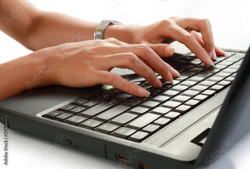 close up of female hand typing on a laptop