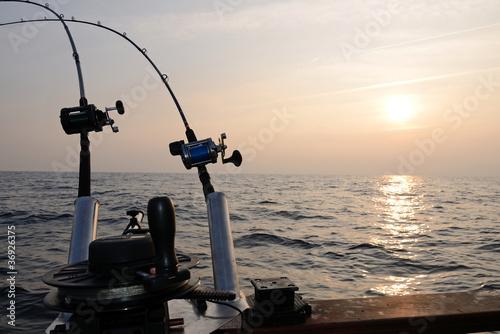 Big game fishing at sunset Poster