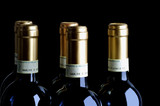 Bottles of fine Italian red wine, black background