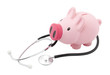 Piggy bank and stethoscope with clipping path