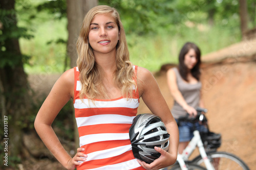 Teenage girls riding their bikes