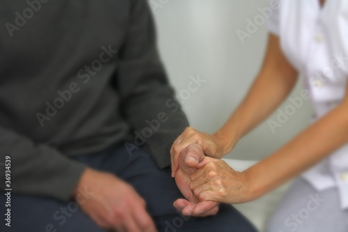 Therapist comforting patient - soft blur