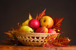 beautiful autumn harvest in basket and leaves