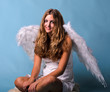 Christmas: Relaxing female angel with blue background