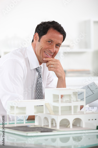 Confident architect in office