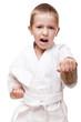 Child boy in kimono training karate