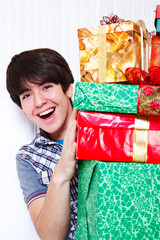 Boy holding presents