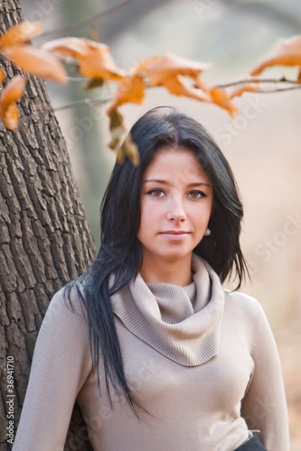 autumn portrait of beautiful young woman