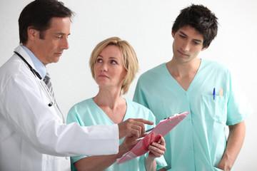 Hospital team reading a chart