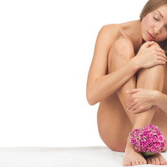 Beautiful naked woman with flower