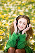 Girl enjoying music outdoors