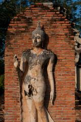 Ancient image Buddha statue in Sukhothai historical park .