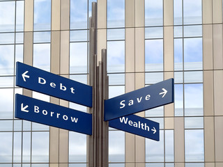 Financial direction sign with office building in background