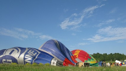 Workers ready hot air balloons before flight