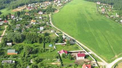 Flight above country houses near Moscow in hot air balloon