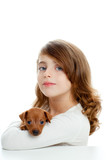 Brunette girl with puppy dog mini pinscher