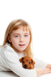 blond kid girl with mini pinscher pet mascot dog