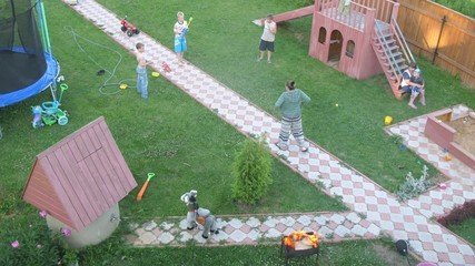 Children play pirates on dacha, top-down view, time lapse